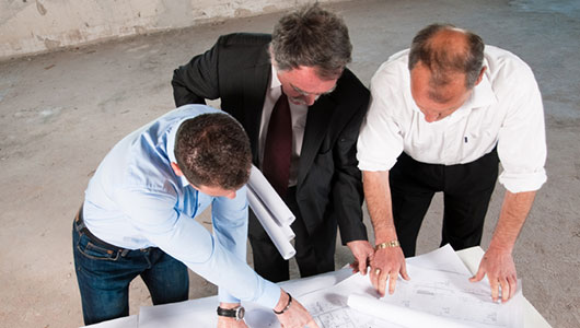 construction project management architects with commercial project plans